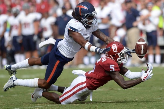 Sep 2, 2017; Norman, OK, USA; UTEP Miners defensive back Kalon Beverly (1) breaks up a pass intended for Oklahoma Sooners wide receiver Marquise Brown (5) during the second quarter at Gaylord Family - Oklahoma Memorial Stadium. Mandatory Credit: Mark D. Smith-USA TODAY Sports