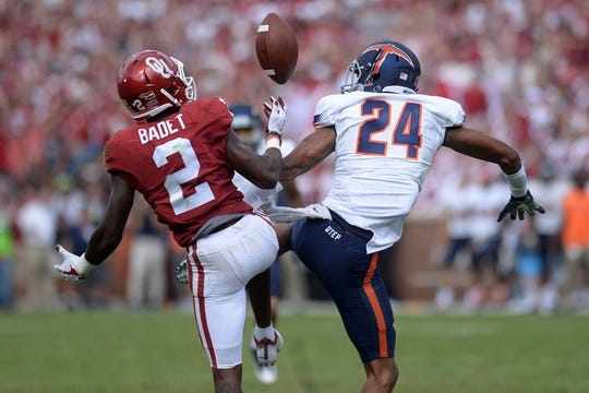 Sep 2, 2017; Norman, OK, USA; Oklahoma Sooners wide receiver Jeff Badet (2) catches a tipped pass in front of UTEP Miners defensive back Kahani Smith (24) during the second quarter at Gaylord Family - Oklahoma Memorial Stadium. Mandatory Credit: Mark D. Smith-USA TODAY Sports