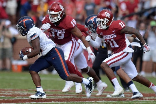 Sep 2, 2017; Norman, OK, USA; UTEP Miners fullback Jonathan Millan (25) eludes a tackle by Oklahoma Sooners cornerback Parnell Motley (11) during the second quarter at Gaylord Family - Oklahoma Memorial Stadium. Mandatory Credit: Mark D. Smith-USA TODAY Sports