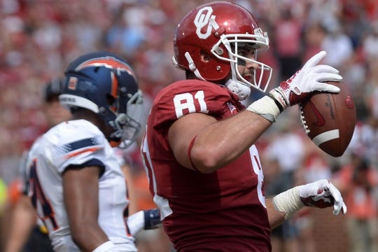 Sep 2, 2017; Norman, OK, USA; Oklahoma Sooners tight end Mark Andrews (81) reacts after scoring a touchdown agains tthe UTEP Miners  during the second quarter at Gaylord Family - Oklahoma Memorial Stadium. Mandatory Credit: Mark D. Smith-USA TODAY Sports