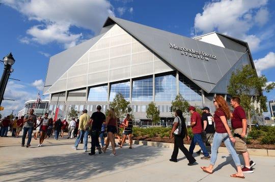 Sep 2, 2017; Atlanta, GA, USA; Fans walk outside Mercedes-Benz Stadium before the Chick-fil-A Kickoff game between Alabama and Florida State. Mandatory Credit: Adam Hagy-USA TODAY Sports