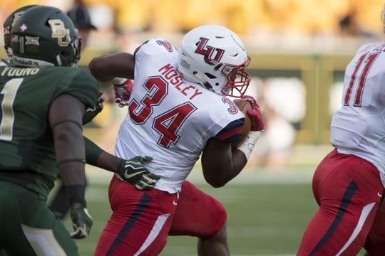 Sep 2, 2017; Waco, TX, USA; Liberty Flames running back Carrington Mosley (34) runs for a first down against the Baylor Bears during the first quarter at McLane Stadium. Mandatory Credit: Jerome Miron-USA TODAY Sports