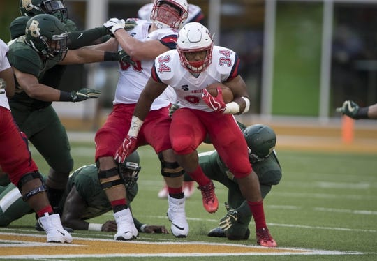 Sep 2, 2017; Waco, TX, USA; Liberty Flames running back Carrington Mosley (34) runs against the Baylor Bears defense during the first quarter at McLane Stadium. Mandatory Credit: Jerome Miron-USA TODAY Sports