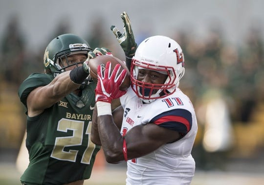 Sep 2, 2017; Waco, TX, USA; Baylor Bears safety Davion Hall (21) defends against Liberty Flames wide receiver Antonio Gandy-Golden (11) during the first quarter at McLane Stadium. Mandatory Credit: Jerome Miron-USA TODAY Sports
