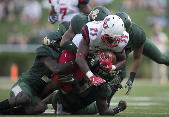 Sep 2, 2017; Waco, TX, USA; Liberty Flames wide receiver Antonio Gandy-Golden (11) is brought down by the Baylor Bears defense during the first quarter at McLane Stadium. Mandatory Credit: Jerome Miron-USA TODAY Sports