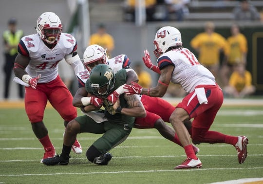 Sep 2, 2017; Waco, TX, USA; Baylor Bears quarterback Anu Solomon (12) is brought down by Liberty Flames defensive end Dia'Vante Brown (44) and linebacker Solomon McGinty (20) and safety Brandon Tillmon (12) during the first quarter at McLane Stadium. Mandatory Credit: Jerome Miron-USA TODAY Sports