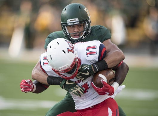 Sep 2, 2017; Waco, TX, USA; Baylor Bears safety Davion Hall (21) tackles Liberty Flames wide receiver Antonio Gandy-Golden (11) during the first quarter at McLane Stadium. Mandatory Credit: Jerome Miron-USA TODAY Sports