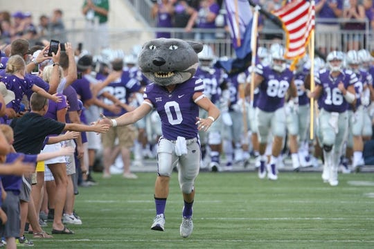 Sep 2, 2017; Manhattan, KS, USA; Kansas State Wildcats mascot Willie Wildcat gives fans high fives as he leads the football team onto the field before a game against the Central Arkansas Bears at Bill Snyder Family Stadium. Mandatory Credit: Scott Sewell-USA TODAY Sports