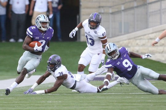 Sep 2, 2017; Manhattan, KS, USA; Kansas State Wildcats defensive back D.J. Reed (2) breaks away from Central Arkansas Bears defensive back Jackie Harvell (36) during the opening kick-off at Bill Snyder Family Stadium. Mandatory Credit: Scott Sewell-USA TODAY Sports