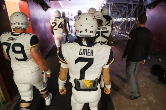 Sep 3, 2017; Landover, MD, USA; West Virginia Mountaineers quarterback Will Grier (7) walks out of the tunnel before their game against the Virginia Tech Hokies at FedEx Field. Mandatory Credit: Ben Queen-USA TODAY Sports