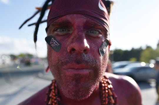 Sep 3, 2017; Landover, MD, USA; A Virginia Tech Hokies fan tailgates in the parking lot prior to a game against the West Virginia Mountaineers at FedEx Field. Mandatory Credit: Derik Hamilton-USA TODAY Sports