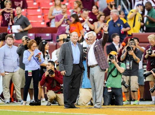 Sep 3, 2017; Landover, MD, USA; West Virginia Mountaineers former head coach Don Nehlen and former Virginia Tech Hokies head coach Frank Beamer wave to the crowd before the game at FedEx Field. Mandatory Credit: Ben Queen-USA TODAY Sports