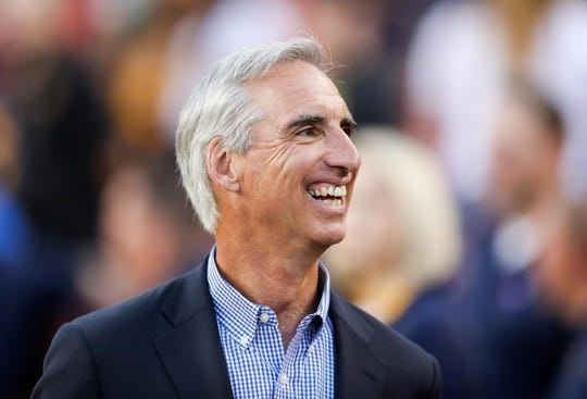Sep 3, 2017; Landover, MD, USA; West Virginia Mountaineers former athletic director Oliver Luck smiles as he walks on the sidelines at FedEx Field. Mandatory Credit: Ben Queen-USA TODAY Sports