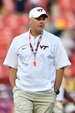 Sep 3, 2017; Landover, MD, USA; Virginia Tech Hokies head coach Justin Fuente walks the field prior to a game against the West Virginia Mountaineers at FedEx Field. Mandatory Credit: Derik Hamilton-USA TODAY Sports