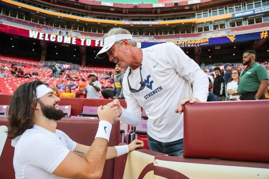 Sep 3, 2017; Landover, MD, USA; West Virginia Mountaineers quarterback Will Grier (7) greets his dad before his game against the Virginia Tech Hokies at FedEx Field. Mandatory Credit: Ben Queen-USA TODAY Sports