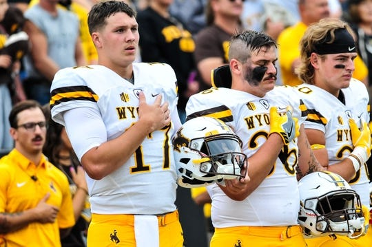 Sep 2, 2017; Iowa City, IA, USA; Wyoming Cowboys quarterback Josh Allen (17) and fullback Drew Van Maanen (36) stand for the national anthem before before the game against the Iowa Hawkeyes at Kinnick Stadium. Mandatory Credit: Jeffrey Becker-USA TODAY Sports