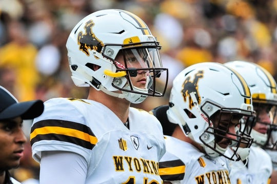 Sep 2, 2017; Iowa City, IA, USA; Wyoming Cowboys quarterback Josh Allen (17) walks onto the field before the game between the Iowa Hawkeyes and the Wyoming Cowboys at Kinnick Stadium. Mandatory Credit: Jeffrey Becker-USA TODAY Sports