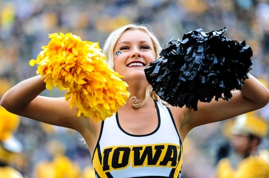 Sep 2, 2017; Iowa City, IA, USA; An Iowa Hawkeyes cheerleader reacts to crowd during the game against the Wyoming Cowboys at Kinnick Stadium. Mandatory Credit: Jeffrey Becker-USA TODAY Sports