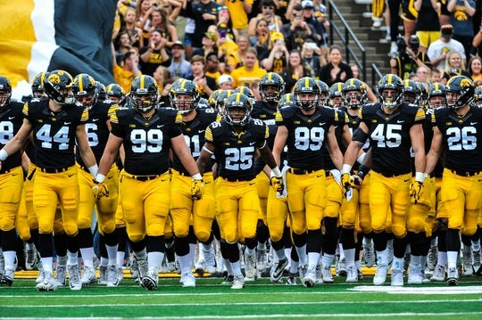 Sep 2, 2017; Iowa City, IA, USA; Iowa Hawkeyes running back Akrum Wadley (25) leads the Iowa Hawkeyes onto the field before the game between the Iowa Hawkeyes and the Wyoming Cowboys at Kinnick Stadium. Mandatory Credit: Jeffrey Becker-USA TODAY Sports
