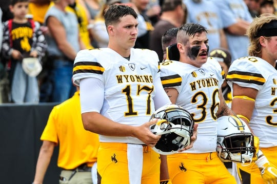 Sep 2, 2017; Iowa City, IA, USA; Wyoming Cowboys quarterback Josh Allen (17) watches from the sideline before the game between the Iowa Hawkeyes and the Wyoming Cowboys at Kinnick Stadium. Mandatory Credit: Jeffrey Becker-USA TODAY Sports