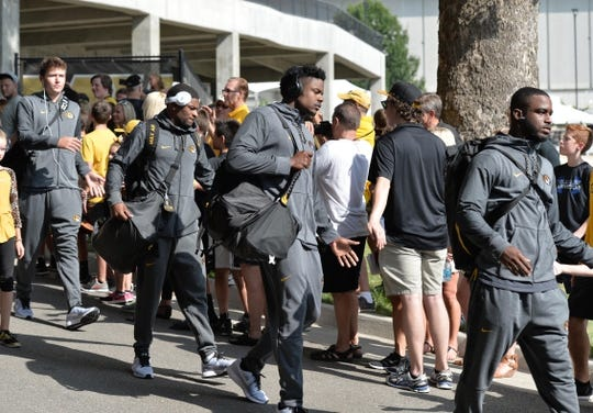 Sep 9, 2017; Columbia, MO, USA; Missouri Tigers quarterback Drew Lock (3) (far left) and players walk into the stadium during the traditional Tiger Walk before the game against the South Carolina Gamecocks at Faurot Field. Mandatory Credit: Denny Medley-USA TODAY Sports