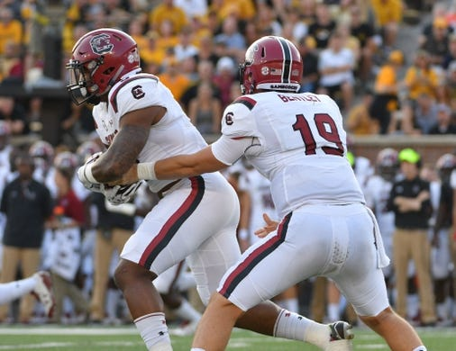 Sep 9, 2017; Columbia, MO, USA; South Carolina Gamecocks quarterback Jake Bentley (19) hands off to running back Rico Dowdle (5) during the first half against the Missouri Tigers at Faurot Field. Mandatory Credit: Denny Medley-USA TODAY Sports