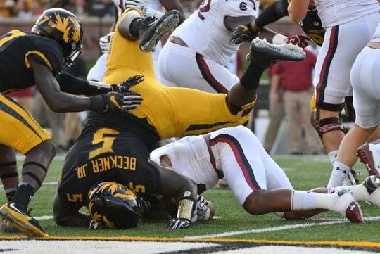 Sep 9, 2017; Columbia, MO, USA; South Carolina Gamecocks running back Rico Dowdle (5) is tackled by Missouri Tigers defensive lineman Terry Beckner Jr. (5) during the first half at Faurot Field. Mandatory Credit: Denny Medley-USA TODAY Sports