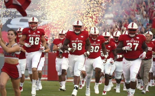 Sep 9, 2017; Raleigh, NC, USA; The North Carolina State Wolfpack take the field prior to a game against the Marshall Thundering Herd at Carter-Finley Stadium. Mandatory Credit: Rob Kinnan-USA TODAY Sports