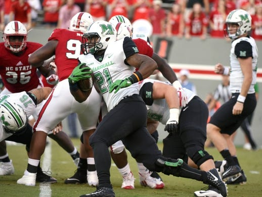 Sep 9, 2017; Raleigh, NC, USA; Marshall Thundering Herd running back Anthony Anderson (21) runs the ball during the first half against the North Carolina State Wolfpack at Carter-Finley Stadium. Mandatory Credit: Rob Kinnan-USA TODAY Sports