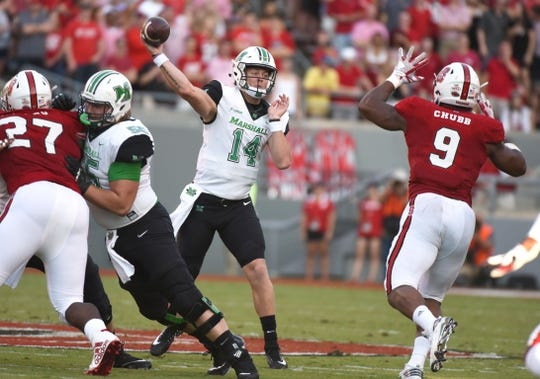 Sep 9, 2017; Raleigh, NC, USA; Marshall Thundering Herd quarterback Chase Litton (14) throws the ball as North Carolina State Wolfpack as defensive end Bradley Chubb (9) pressures during the first half at Carter-Finley Stadium. Mandatory Credit: Rob Kinnan-USA TODAY Sports