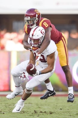 Sep 9, 2017; Los Angeles, CA, USA; Stanford Cardinal wide receiver JJ Arcega-Whiteside (19) catches the ball defended by Southern California Trojans cornerback Iman Marshall (8) during the first quarter at Los Angeles Memorial Coliseum. Mandatory Credit: Kelvin Kuo-USA TODAY Sports