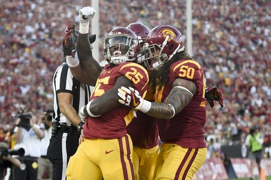 Sep 9, 2017; Los Angeles, CA, USA; Southern California Trojans running back Ronald Jones II (25) celebrates a touchdown against the Stanford Cardinal during the first quarter at Los Angeles Memorial Coliseum. Mandatory Credit: Kelvin Kuo-USA TODAY Sports