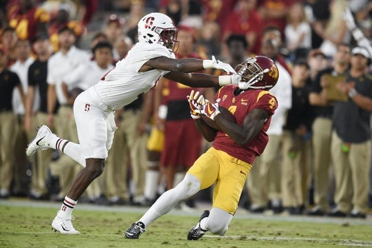 Sep 9, 2017; Los Angeles, CA, USA; Southern California Trojans wide receiver Steven Mitchell Jr. (4) catches the ball for a first down while defended by Stanford Cardinal safety Frank Buncom (5) during the second quarter at Los Angeles Memorial Coliseum. Mandatory Credit: Kelvin Kuo-USA TODAY Sports