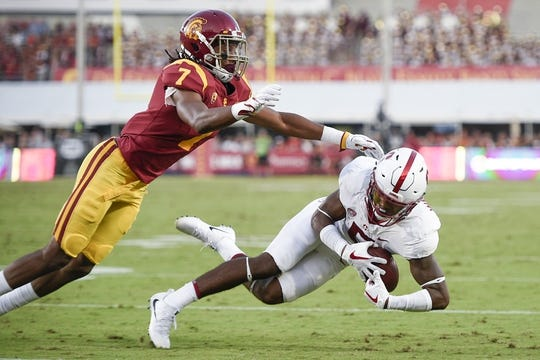 Sep 9, 2017; Los Angeles, CA, USA; Stanford Cardinal wide receiver Connor Wedington (5) catches the ball while defended by Southern California Trojans safety Marvell Tell III (7) during the second quarter at Los Angeles Memorial Coliseum. Mandatory Credit: Kelvin Kuo-USA TODAY Sports