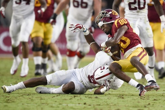 Sep 9, 2017; Los Angeles, CA, USA; Southern California Trojans wide receiver Deontay Burnett (80) loses his helmet while being tackled by Stanford Cardinal safety Frank Buncom (5) during the second quarter at Los Angeles Memorial Coliseum. Mandatory Credit: Kelvin Kuo-USA TODAY Sports