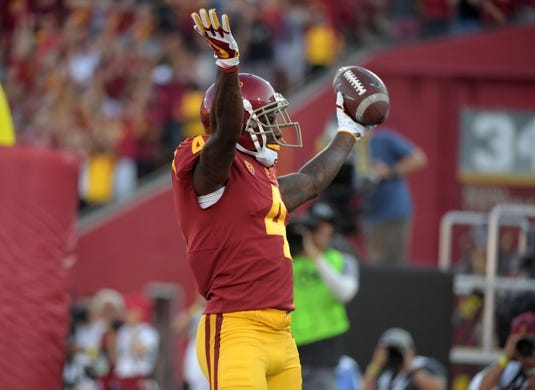 Sep 9, 2017; Los Angeles, CA, USA; Southern California wide receiver Steven Mitchell Jr. (4) celebrates after scoring on a 4-yard touchdown reception in the first quarter against the Stanford Cardinal during a NCAA football game at Los Angeles Memorial Coliseum. Mandatory Credit: Kirby Lee-USA TODAY Sports