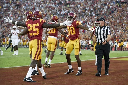 Sep 9, 2017; Los Angeles, CA, USA; Southern California Trojans wide receiver Deontay Burnett (80) celebrates his touchdown with Southern California Trojans running back Ronald Jones II (25) against the Stanford Cardinal during the second quarter at Los Angeles Memorial Coliseum. Mandatory Credit: Kelvin Kuo-USA TODAY Sports