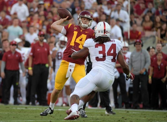 Sep 9, 2017; Los Angeles, CA, USA; Southern California quarterback Sam Darnold (14) throws a touchdown pass in the first quarter under pressure from Stanford Cardinal cornerback Quenton Meeks (24) during a NCAA football game at Los Angeles Memorial Coliseum. Mandatory Credit: Kirby Lee-USA TODAY Sports