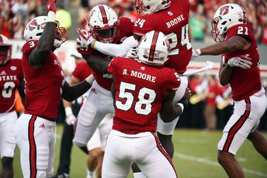 Sep 9, 2017; Raleigh, NC, USA; North Carolina State Wolfpack players celebrate a tackle on special teams during the first half against the Marshall Thundering Herd at Carter-Finley Stadium. Mandatory Credit: Rob Kinnan-USA TODAY Sports