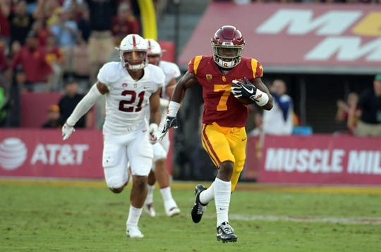 Sep 9, 2017; Los Angeles, CA, USA; Southern California Trojans running back Stephen Carr (7) carries the ball on a 52-yard run against the Stanford Cardinal during a NCAA football game at Los Angeles Memorial Coliseum. Mandatory Credit: Kirby Lee-USA TODAY Sports