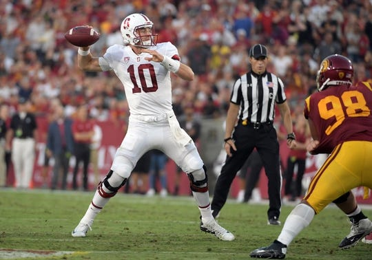Sep 9, 2017; Los Angeles, CA, USA; Stanford Cardinal quarterback Keller Chryst (10) throws a pass against the Southern California Trojans during a NCAA football game at Los Angeles Memorial Coliseum. Mandatory Credit: Kirby Lee-USA TODAY Sports