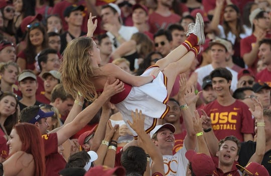 Sep 9, 2017; Los Angeles, CA, USA; Southern California Trojans fans celebrate after a touchdown against the Stanford Cardinal during a NCAA football game at Los Angeles Memorial Coliseum. Mandatory Credit: Kirby Lee-USA TODAY Sports