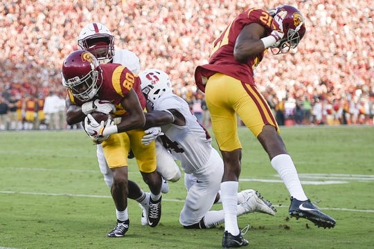 Sep 9, 2017; Los Angeles, CA, USA; Southern California Trojans wide receiver Deontay Burnett (80) runs toward the end zone while being tackled by Stanford Cardinal cornerback Quenton Meeks (24) during the first quarter at Los Angeles Memorial Coliseum. Mandatory Credit: Kelvin Kuo-USA TODAY Sports