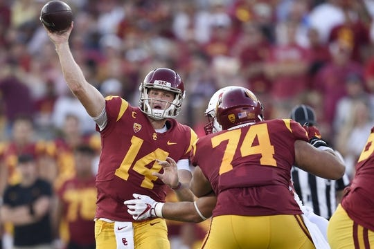 Sep 9, 2017; Los Angeles, CA, USA; Southern California Trojans quarterback Sam Darnold (14) passes the ball against the Southern California Trojans during the second quarter at Los Angeles Memorial Coliseum. Mandatory Credit: Kelvin Kuo-USA TODAY Sports