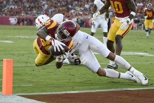 Sep 9, 2017; Los Angeles, CA, USA; Southern California Trojans wide receiver Deontay Burnett (80) dives in for the touchdown while defended by Stanford Cardinal cornerback Alijah Holder (13) during the second quarter at Los Angeles Memorial Coliseum. Mandatory Credit: Kelvin Kuo-USA TODAY Sports