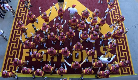Sep 9, 2017; Los Angeles, CA, USA; Southern California Trojans head coach Clay Helton leads players onto the field during a NCAA football game against the Stanford Cardinal at Los Angeles Memorial Coliseum. Mandatory Credit: Kirby Lee-USA TODAY Sports