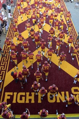 Sep 9, 2017; Los Angeles, CA, USA; Southern California Trojans players walk onto the field during a NCAA football game against the Stanford Cardinal at Los Angeles Memorial Coliseum. Mandatory Credit: Kirby Lee-USA TODAY Sports