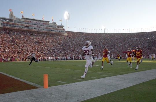 Sep 9, 2017; Los Angeles, CA, USA; Stanford Cardinal running back Bryce Love (20) scores on a 75-yard touchdown run in the first quarter against the Southern California Trojans during a NCAA football game at Los Angeles Memorial Coliseum. Mandatory Credit: Kirby Lee-USA TODAY Sports