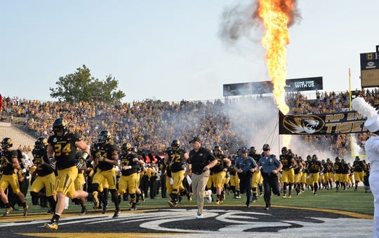 Sep 9, 2017; Columbia, MO, USA; Missouri Tigers head coach Barry Odom and players run onto the field before the game against the South Carolina Gamecocks at Faurot Field. Mandatory Credit: Denny Medley-USA TODAY Sports