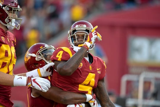 Sep 9, 2017; Los Angeles, CA, USA; USC Trojans wide receiver Steven Mitchell Jr. (4) reacts after catching a touchdown pass during a NCAA football game against the Stanford Cardinal at Los Angeles Memorial Coliseum. Mandatory Credit: Kirby Lee-USA TODAY Sports